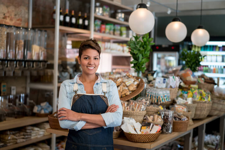 Latin American woman working at a grocery store – small business concepts
